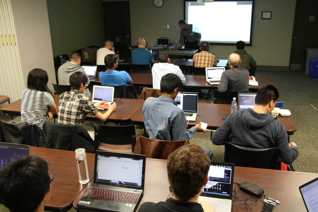 A dozen programmers came in to learn the language.
